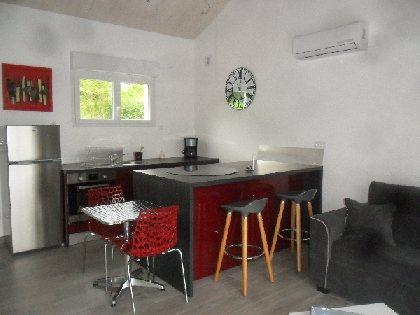 cuisine avec ilot central ouvert sur le salon, OFFICE DE TOURISME DE CRANSAC